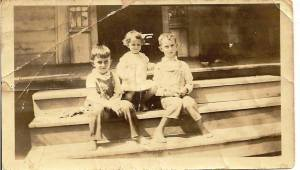 My grandfather, Aunt Sissy and Uncle Kiddo on the front steps of Riverside.